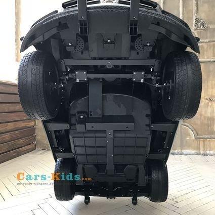 Электромобиль Mercedes-Benz SLS AMG Carbon Edition (колеса резина, сиденье кожа, пульт, музыка, электроусилитель)